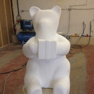 Polystyrene shaped Panda with present