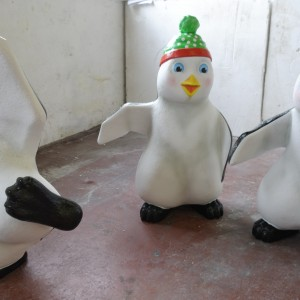 Playful penguin props, customised Christmas props