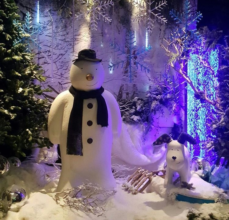 snowman and snow dog sculptures we created - Finish display by Chic Flower Design