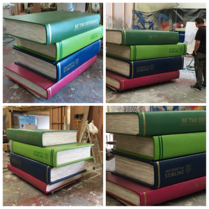 Giant stack of books prop for graduation ceremony
