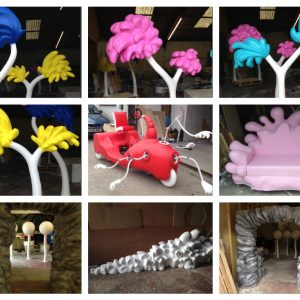 Dr Seuss themed props for Discover story centre, colourful trees, a bubble sofa, a themed white bush, cave like tunnel