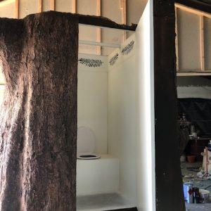 Unique compost toilet inside a tree