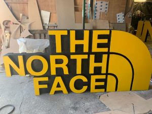 large 3d letters the north face unlock the drop